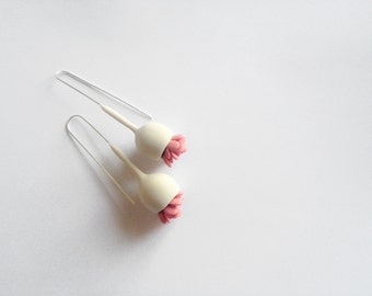 minimalistic hand-sculpted bell flower polymer clay earrings with pink leaves