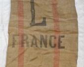 France, straw mended Vintage walnut sack, red and black sandy burlap sack.