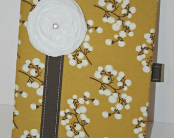 Fabric covered composition journal with pen holder and page marker.