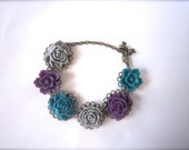 Cabochon bracelet in teal, purple and grey