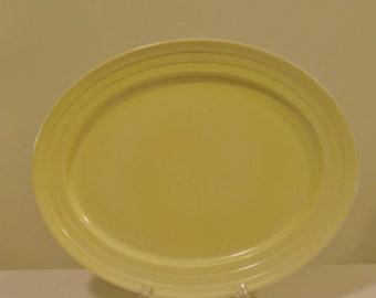 Hazel Atlas Moderntone Platonite Oval Yellow Ribbed Serving Platter on White Milk Glass