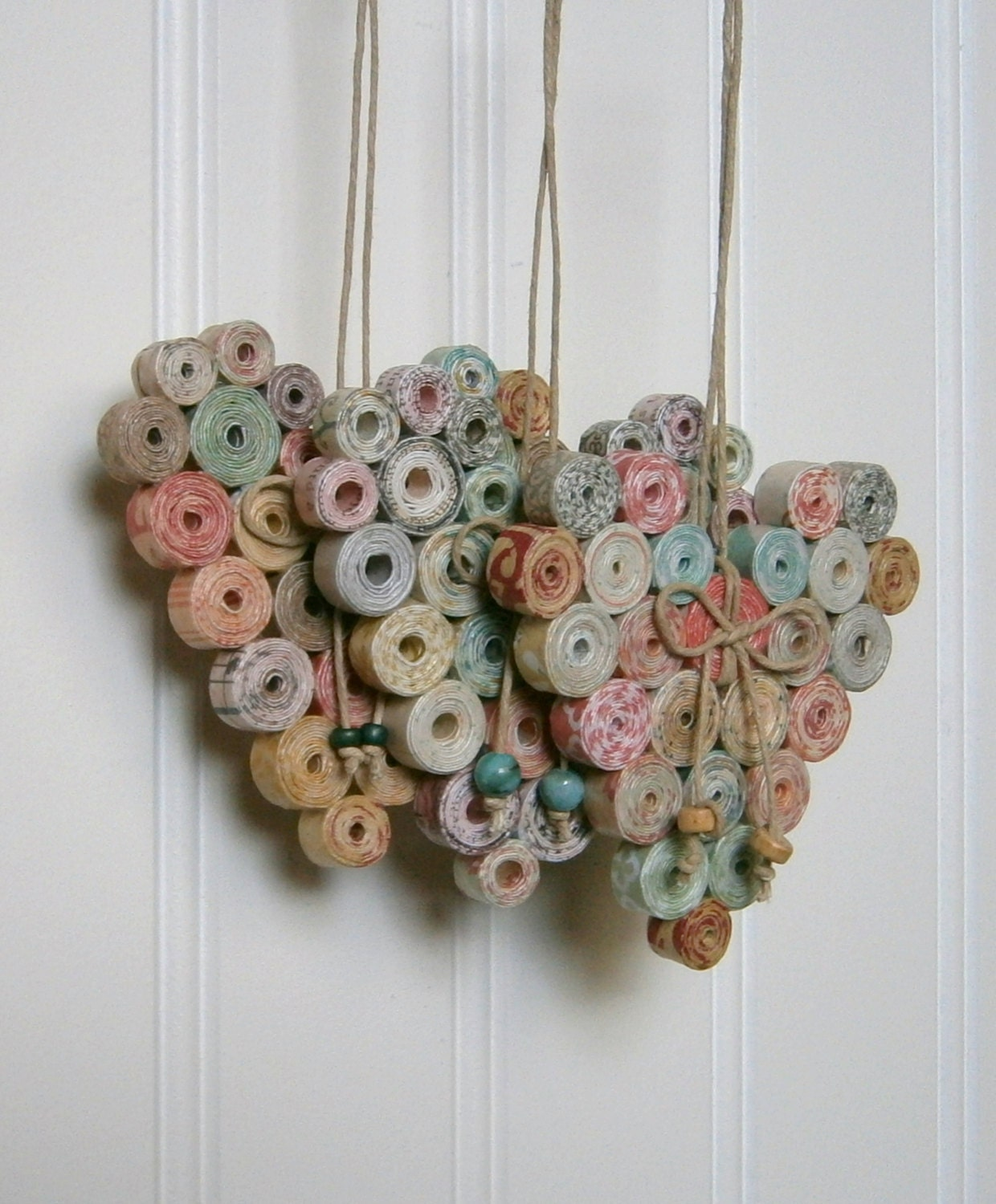 Coiled paper heart ornament recycled and reused paper for Recycled decorative items