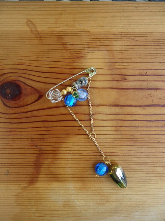 Grass and the Water Droplet: pin with ocean, sky blue, and gold and green-tone glass beads, gold chain