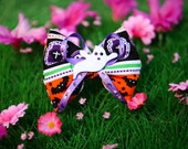 Halloween hair bow with cute gravestone and bat print, purple ribbon and a white felt ghost