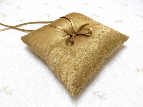 Gold wedding ring pillow. Gold satin ring bearer. Golden floral lace on top. Gold satin ribbon.