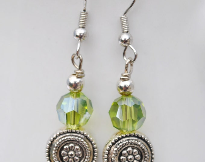 Olive green crystal and flower carved silver tone bead earrings
