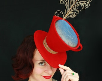 Custom Order: Mad Hatter Tea Cup Red Felt Tilt Hat with Iridescent Liquid Beverage and Curling Feather for Steam