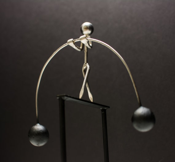 The tightrope walker physics desk toy kinetic by kyleskinetics for Kinetic desk sculpture