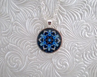 Blue and brown abstract kaleidoscope pendant necklace