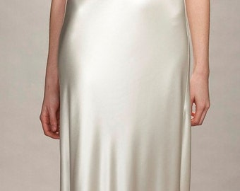 1930s inspired bias cut liquid silk satin V-neck low back wedding dress with bell sleeves and Swarovski crystal embellishment detail