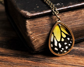 Butterfly wing necklace, antique brass necklace, tear drop necklace, tear drop pendant, glass necklace, yellow necklace, butterfly necklace