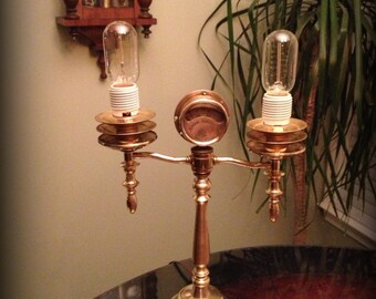 Handmade Steampunk candlestick style lamp made from vintage and antique recycled brass parts for a dimmable light with victorian charm