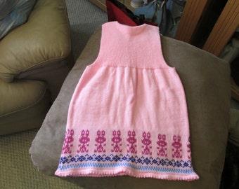 machine knit girl's jumper; Easter dress; jumper; girl's jumper; girl's pink dress; pink jumper dress embellished with bunnies; knit jumper
