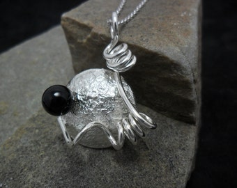 An onyx Pearl adorned reticulated Silver Pendant