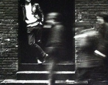 "John Lennon In A Doorway In Hamburg, Germany. Photograph by Jurgen Vollmer 1961 (22""x28"") 1991 Beatles Collectible Poster Print"