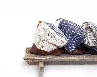 Leather Clutch. Foldover Clutch. Lace Clutch. Travel Bag. Ikat Clutch. Travel Case. Makeup Bag. Zippered Pouch. Brown Leather Clutch. Purse