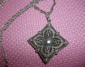 Vintage Celebrity Pendant Necklace With A Double Sided Floral Filigree Pendant