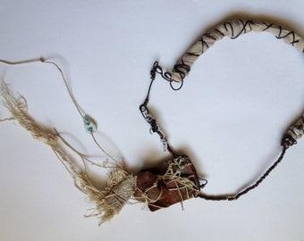 Ancient modern primitive necklace calling on ancient wisdoms