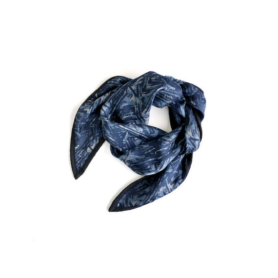 Deep indigo silk scarf in a Hawaiian tapa cloth motif with graphite trim.