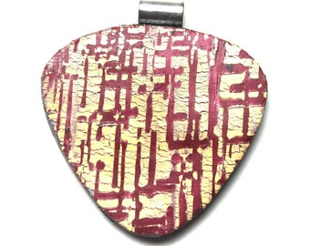 polymer clay pendant in red and yellow modern crosshatch design