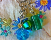 Filofax Planner Agenda charm - The aqua / green/ blue beads hang from silver chains.