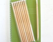 8 natural wood pencils with white arrow