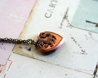 dragon. locket necklace. copper ox