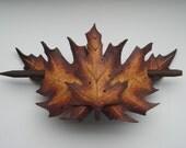 Leather layered red oak barrette