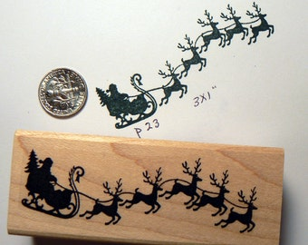 Santa Claus with sled rubber stamp P23