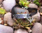 We're All Stories in the End - hand-stamped aluminum bracelet