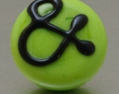Lapel pin - Pea green ampersand - lampwork glass by Jennie Yip