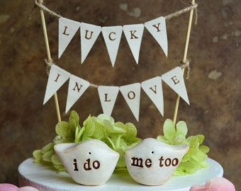 "Wedding cake topper and ""lucky in love"" banner...package deal ... i do, me too love birds and fabric banner included"