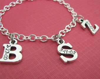sterling silver initial with date charm bracelet