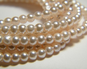 3mm round pink glass pearls, strand aprox. 26 inches