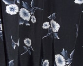 Cotton fabric black with silver white flowers.