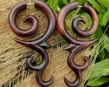 fake gauge earrings Hand Craved Natural Sono Wood Split Gauge Earrings Sprial tribal fake piercings