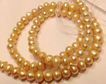 "Freshwater Pearl A-AA round potato pearl yellow and champagne pearl--5-6mm Full Strand15"" strand #RS2020"