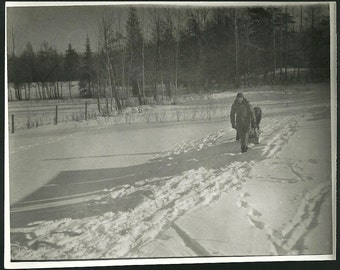 Vintage Winter Photograph Man Pulls Child And Firewood In Snow From Forest Outdoors Photo