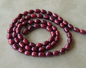 Burgundy Rice Pearls (2391)