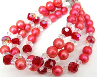 Vintage triple strand cuff bracelet with hot pink faux pearls, clear and red faceted glass beads, silver clasp