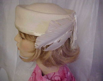 White wool designer pill box hat with feathers and rows of white fringes- cute- fits 22 inches