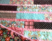 lap size (40'X72') pink aqua brown quilt of whimsical modern fabric that will grow with the blessing in your life.