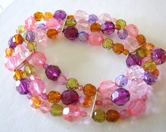 Pretty triple strand pink, purple, green and orangle beaded stretch bracelet with silver accents