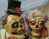 hand painted paper mache skulls