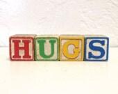 hugs - vintage wooden letter blocks - hugs