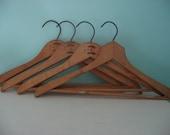 collection of vintage wood coat room hangers