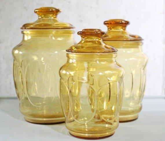 vintage honey colored glass canister set
