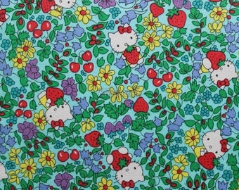 Liberty tana lawn - Strawberry fields - Hello Kitty printed in Japan - Light blue mix