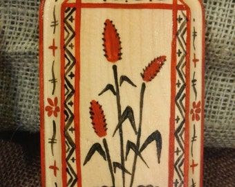 Cattail painting on wooden board in the Russian traditional Mezen style, folk art painting on wood
