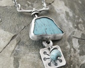 Turquoise necklace with a Thai Silver charm. 00139